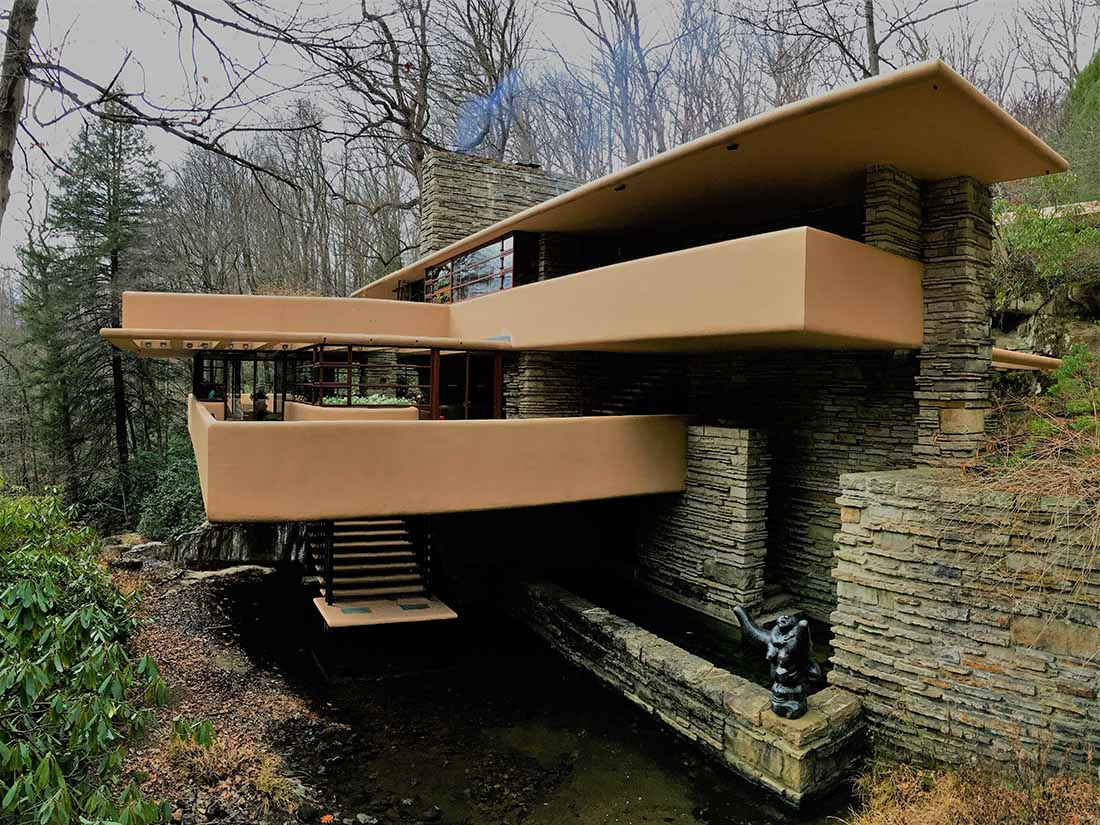 Fallingwater residence perched on a rocky bluff.