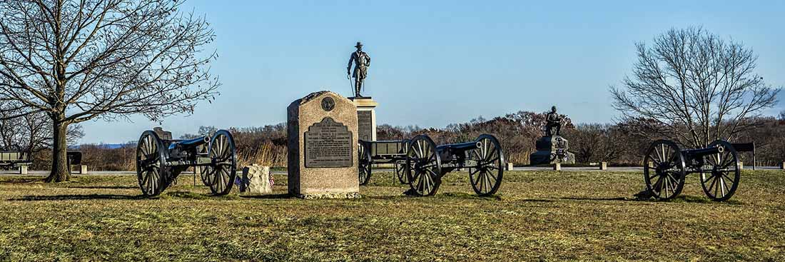 Memorials and cannons arrayed across the Gettysburg Battlefield.