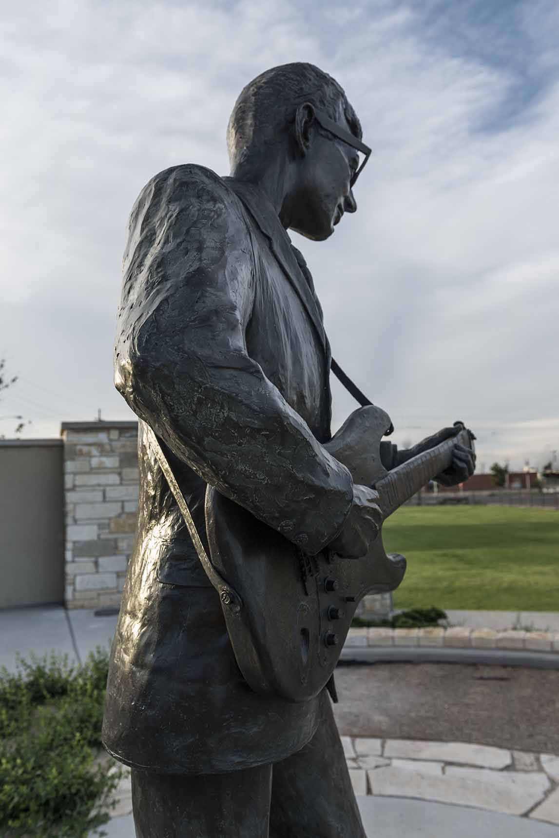 A statue of rock icon Buddy Holly with guitar.