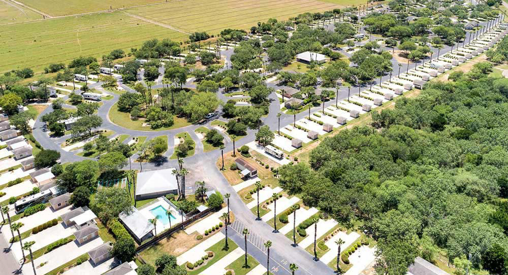 Aerial shot of RVs in a lush resort