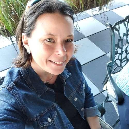 Woman taking selfie on a patio