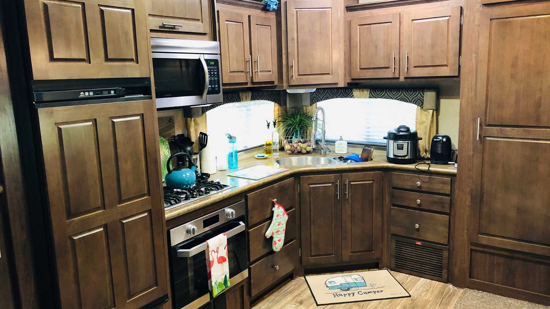 RV kitchen with oven and microwave.