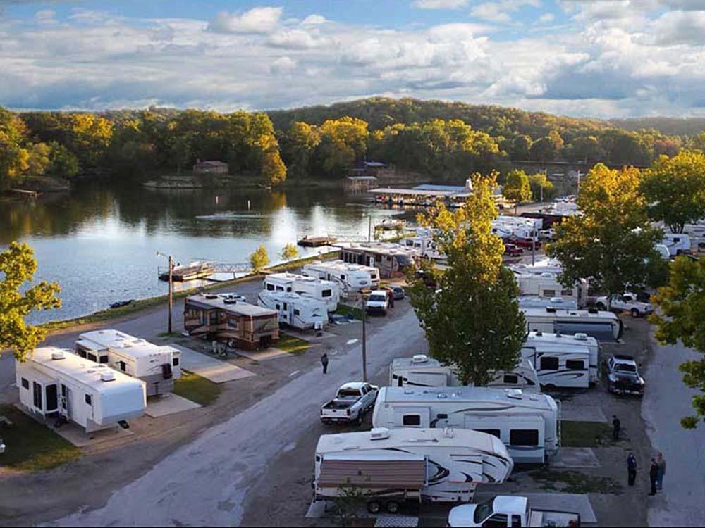 RVs parked along a lakeside.