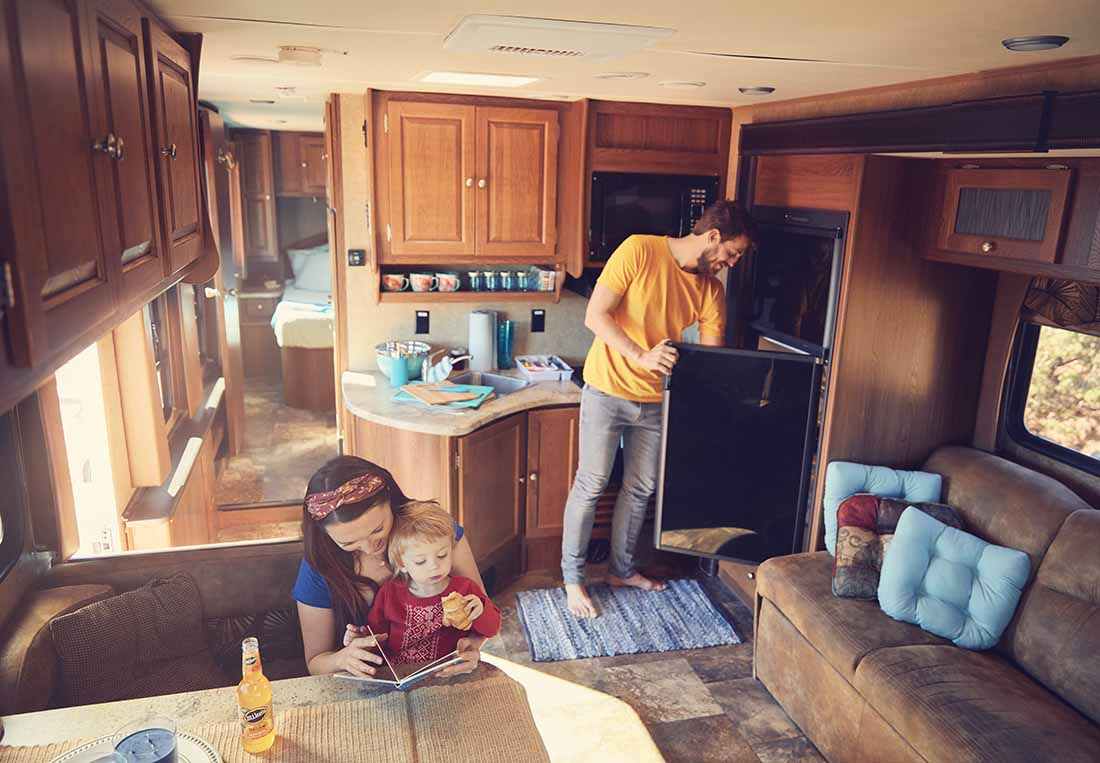 A family relaxing in their RV.