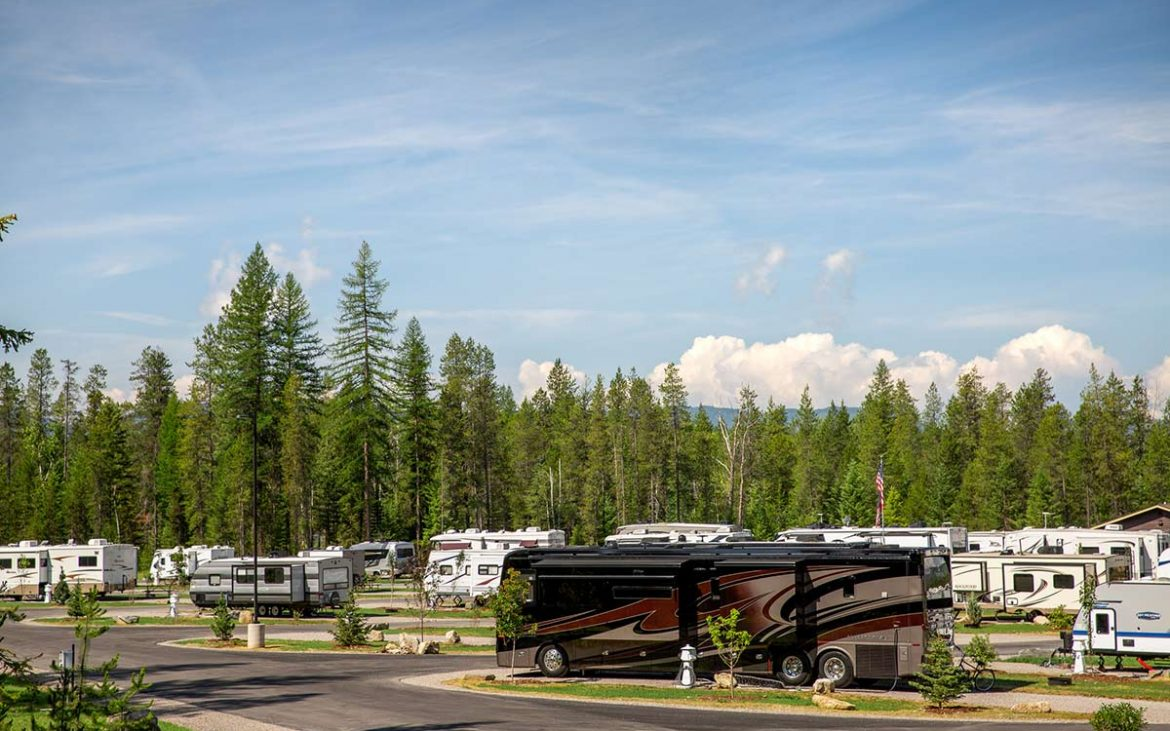 RV Park with motorhomes parked in woody RV park in Montana