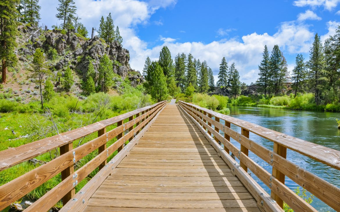 Wooden bridge along a trail on a sunny day in Bend, Oregon