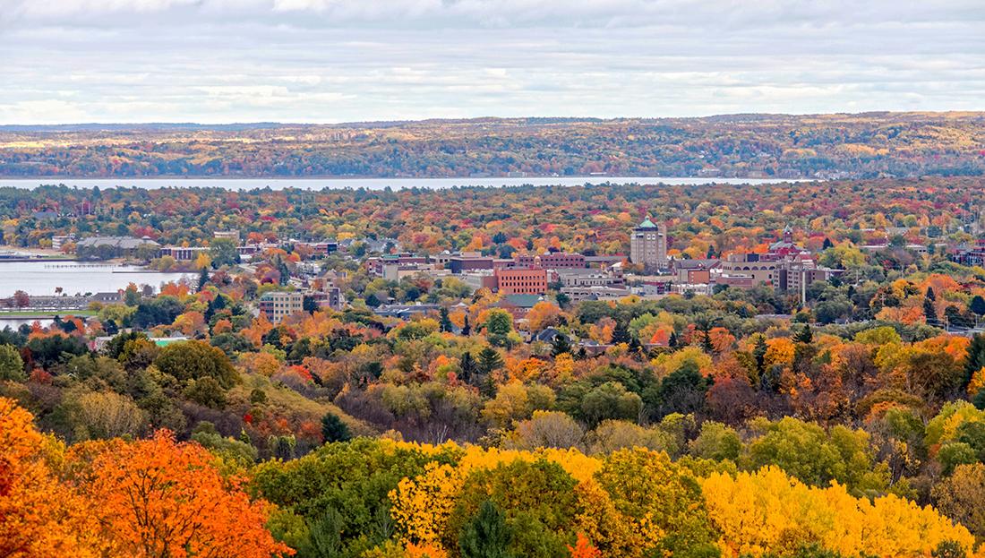 A fall landscapes surrounds buildings.