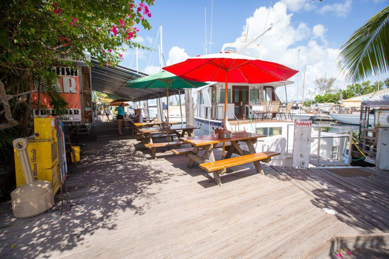 Boats docked to a dining patio.
