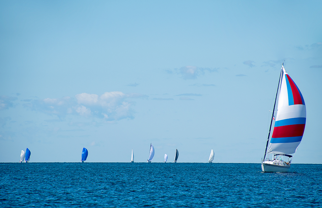 racing sailboats with spinnakers on Lake Michigan