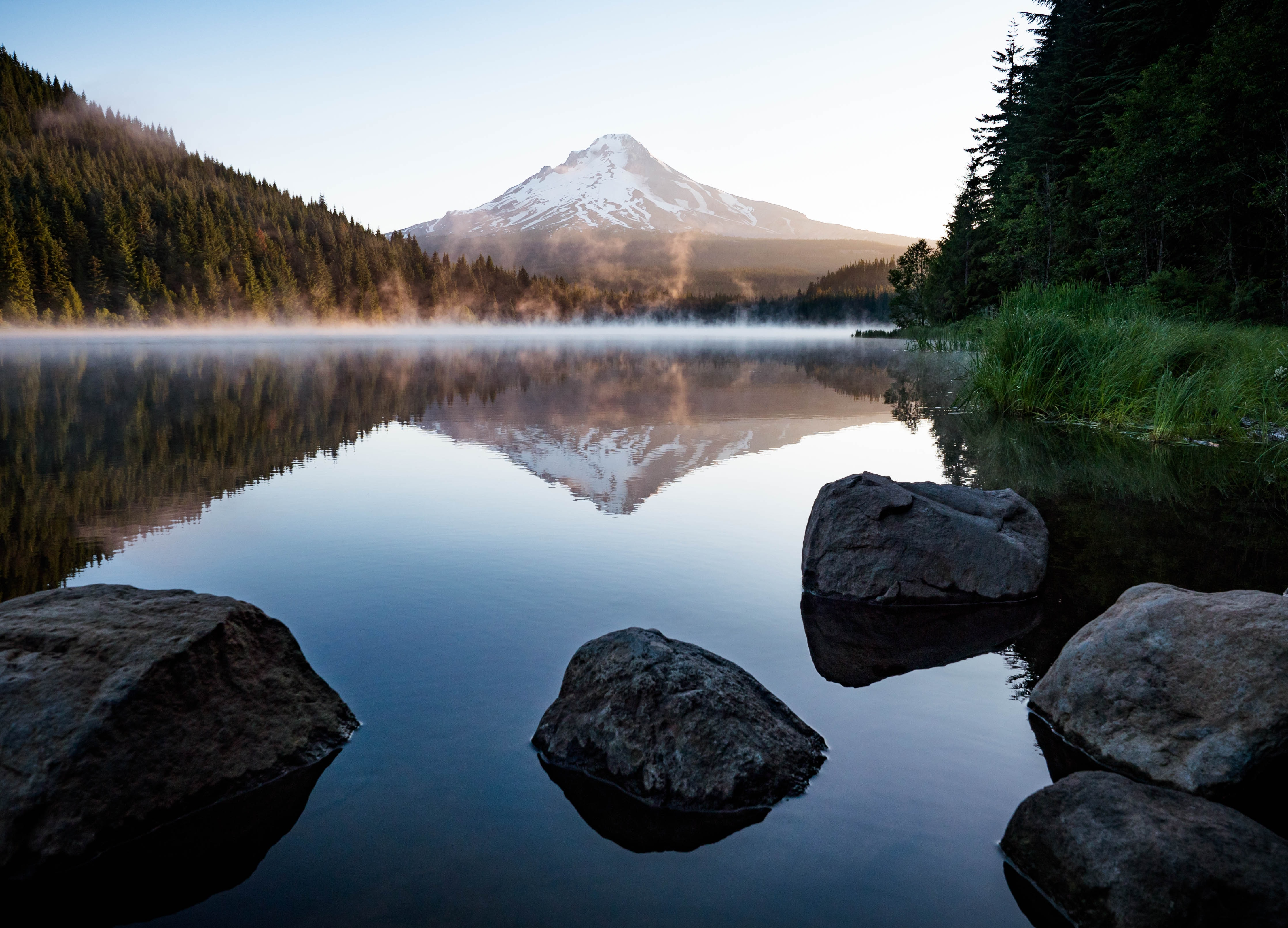 A mountain reflected in a placid lake.