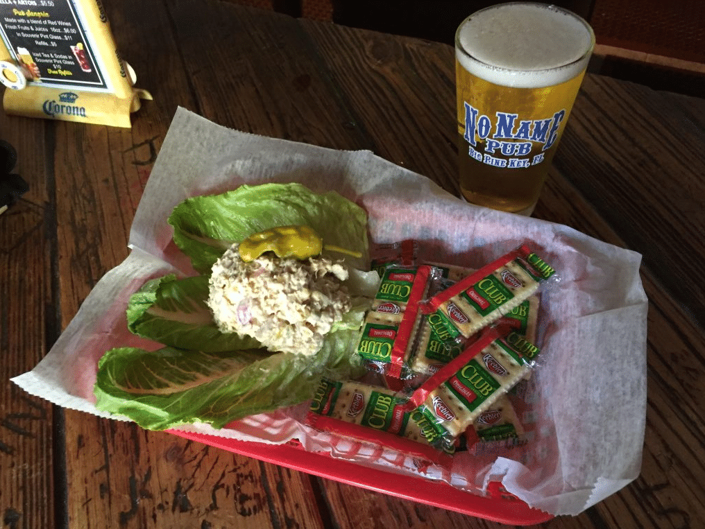 Salad and beer with crackers