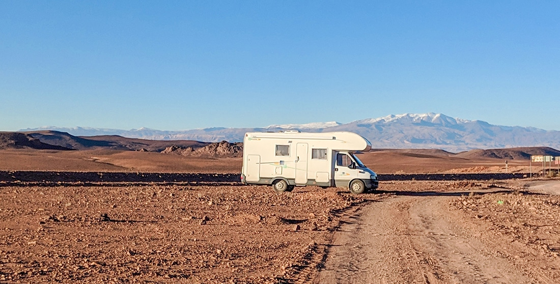 An RV driving in the desert