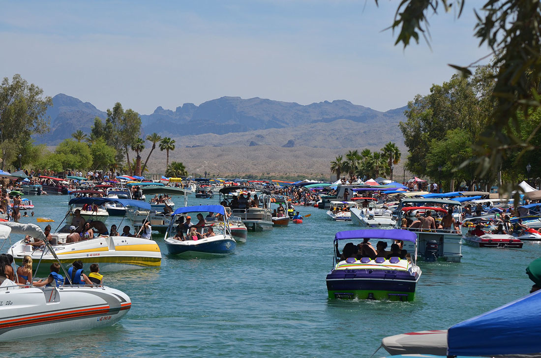 Boats filled with spring break partygoers cruise on Lake Havasu.