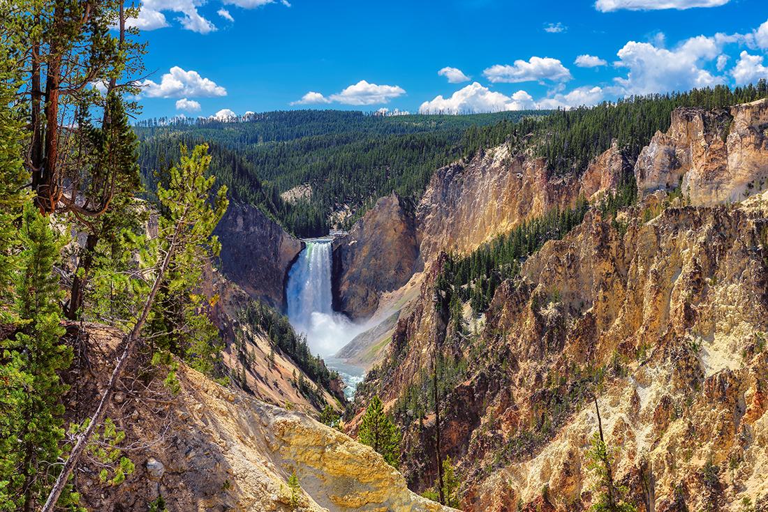 A waterfall cascades down a cliff face.