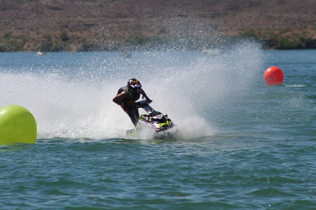 A jet ski zooms across the water.