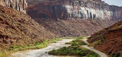 A river runs through a rugged canyon floor.