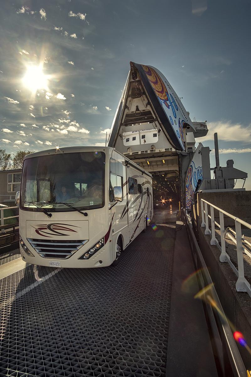 An RV drives off the a ferry.