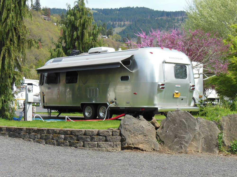 Airstream trailer parked with hookups.