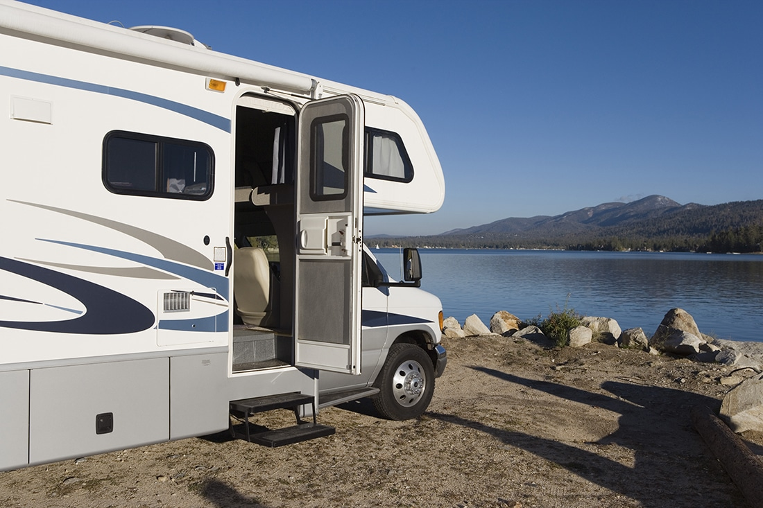 RV parked by a lake