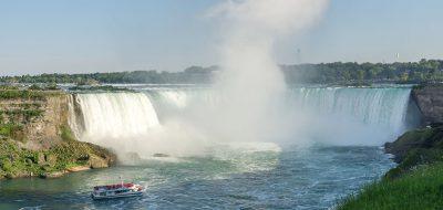 A boat churns close to the foot of Niagara Falls.