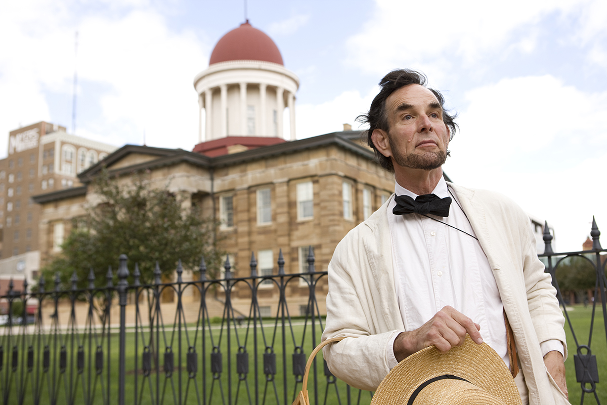 An Abe Lincoln reenactor gazing into space.