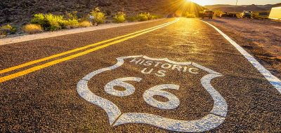Historic Route 66 running through rugged desert country.