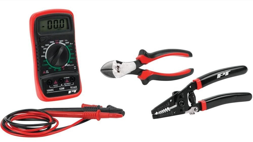 A multimeter with wire cutters and wire stripper