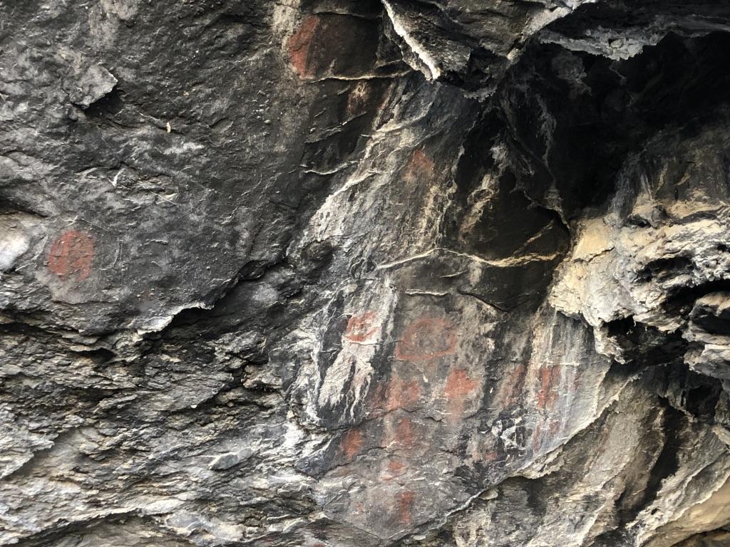 Pictographs adorn sharp cave walls.