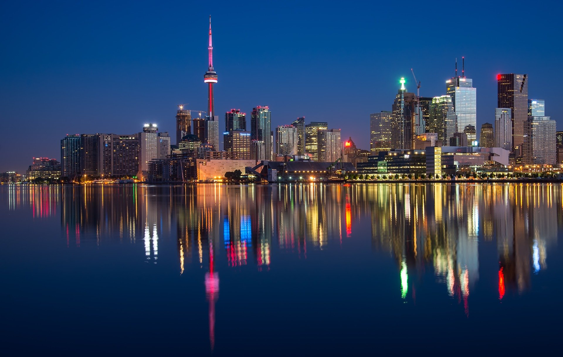 City skyline reflected on water.