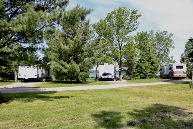 RVs parked on well-groomed grounds of an RV park.