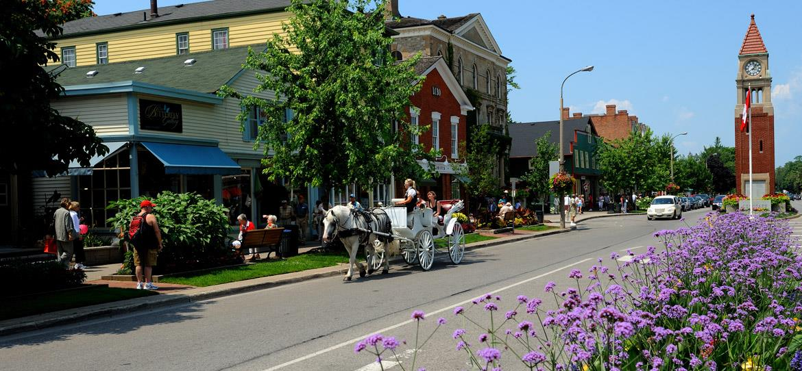 Horse-drawn carriages in quant town.