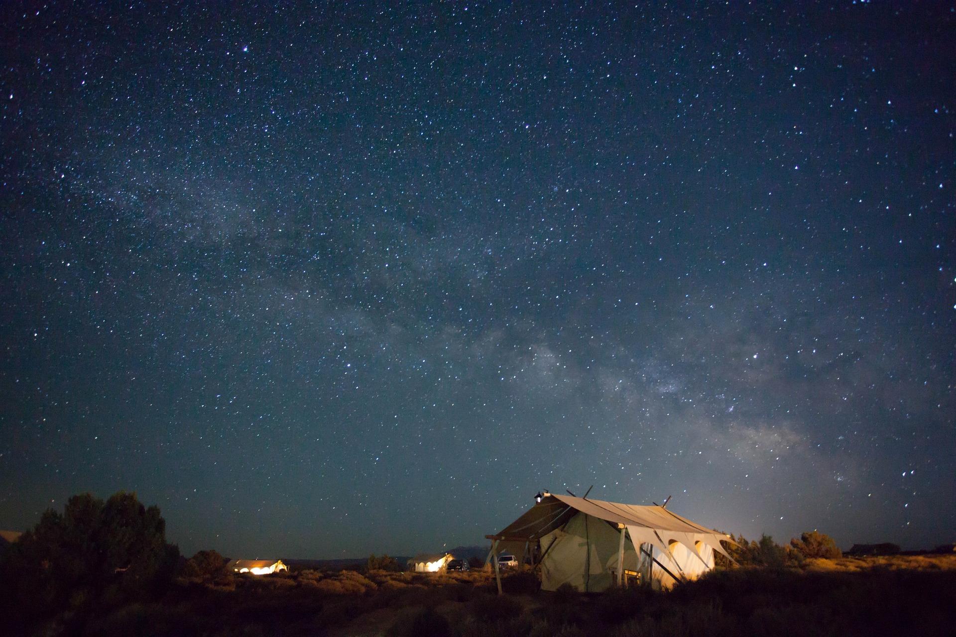 Big tent under a night sky.