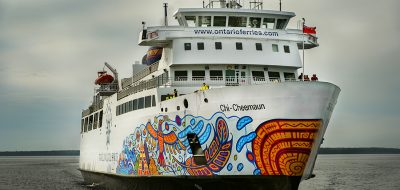 Ship with colorfully painted hull.