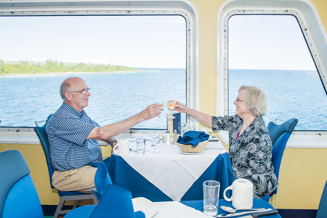 A couple make a toast aboard the Chi-Cheemaun