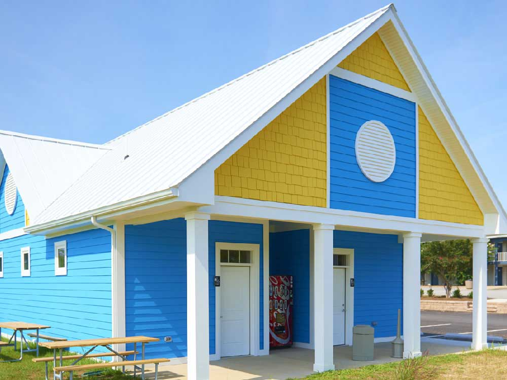 Colorfully painted a-frame restroom facilities.