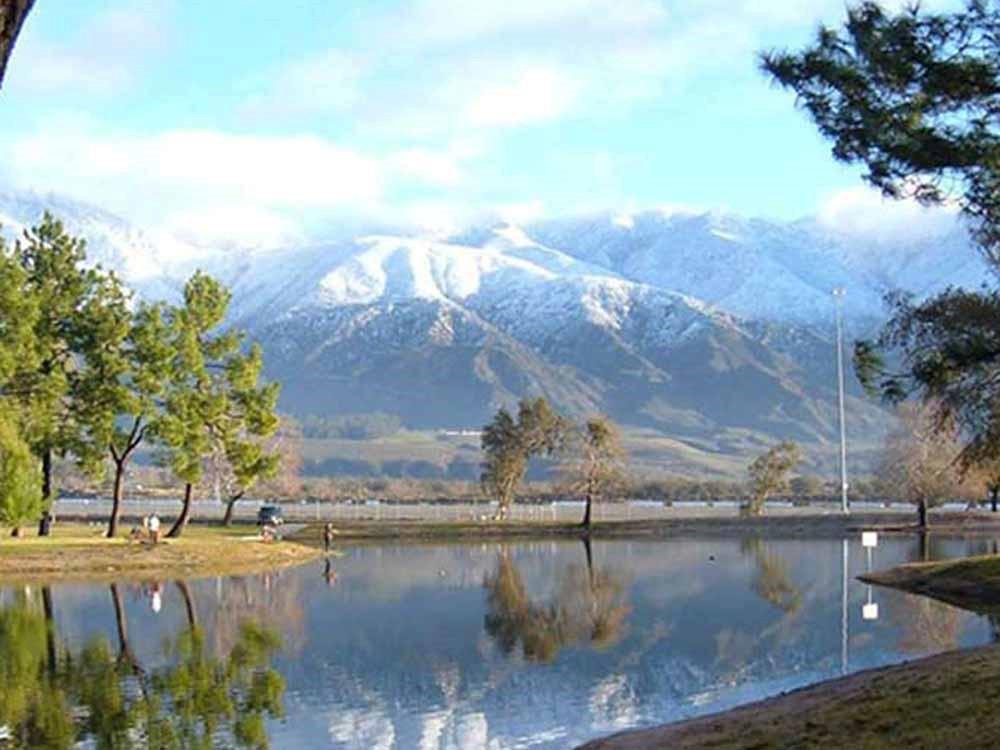 A lake reflecting a scenic mountain.