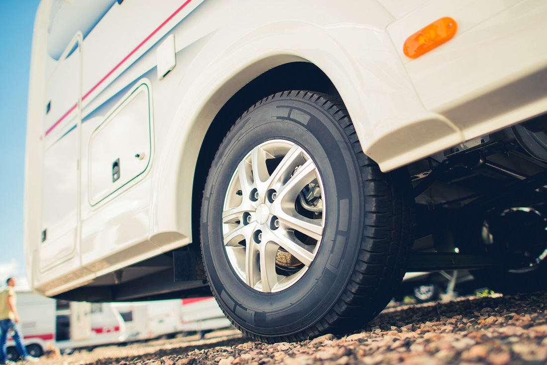 Ground-level view of motorhome tires.