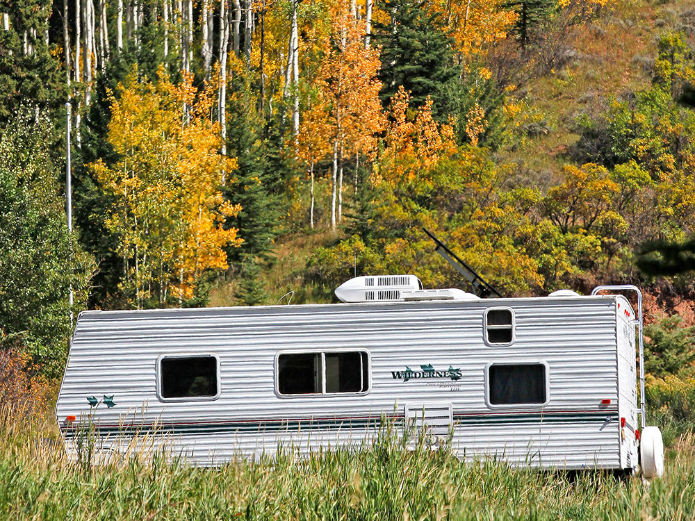 Trailer against a forest backdrop.