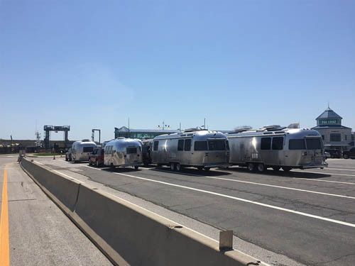Silver bullet airstream trailers near ferry.