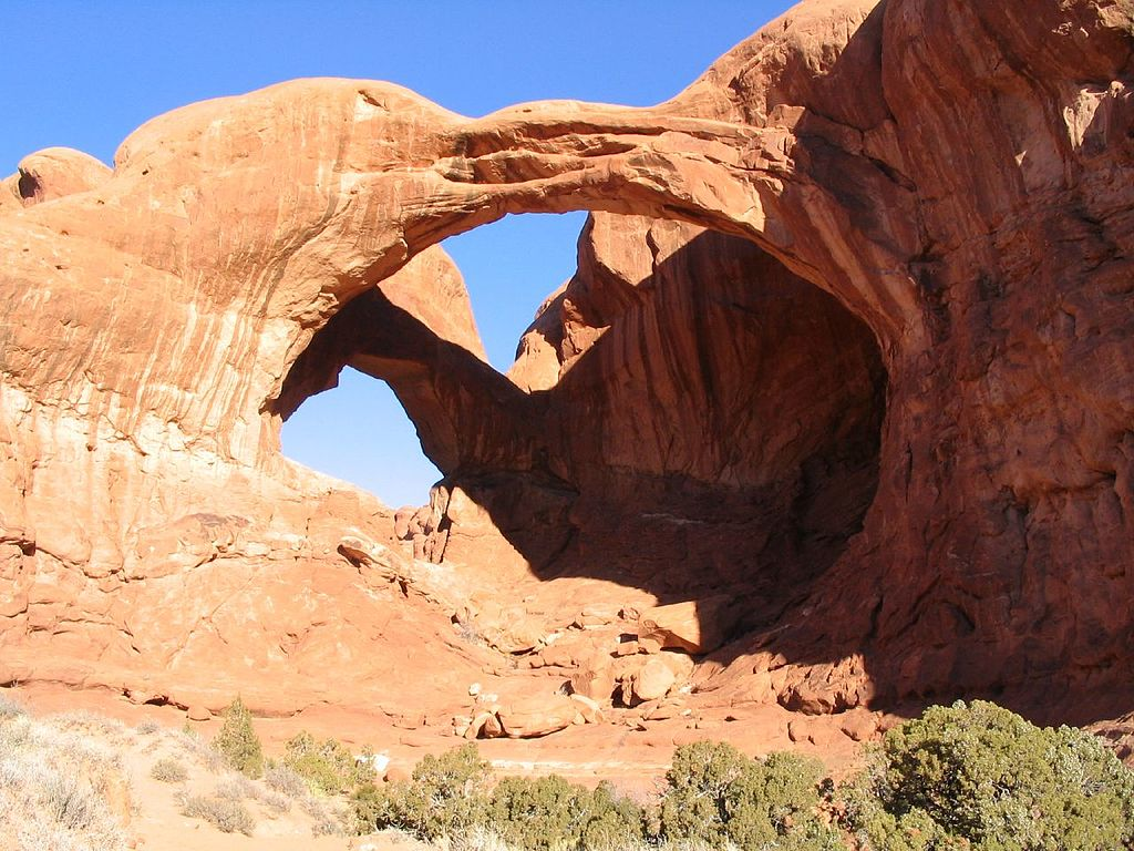 Rock arches against a clear blue sky.