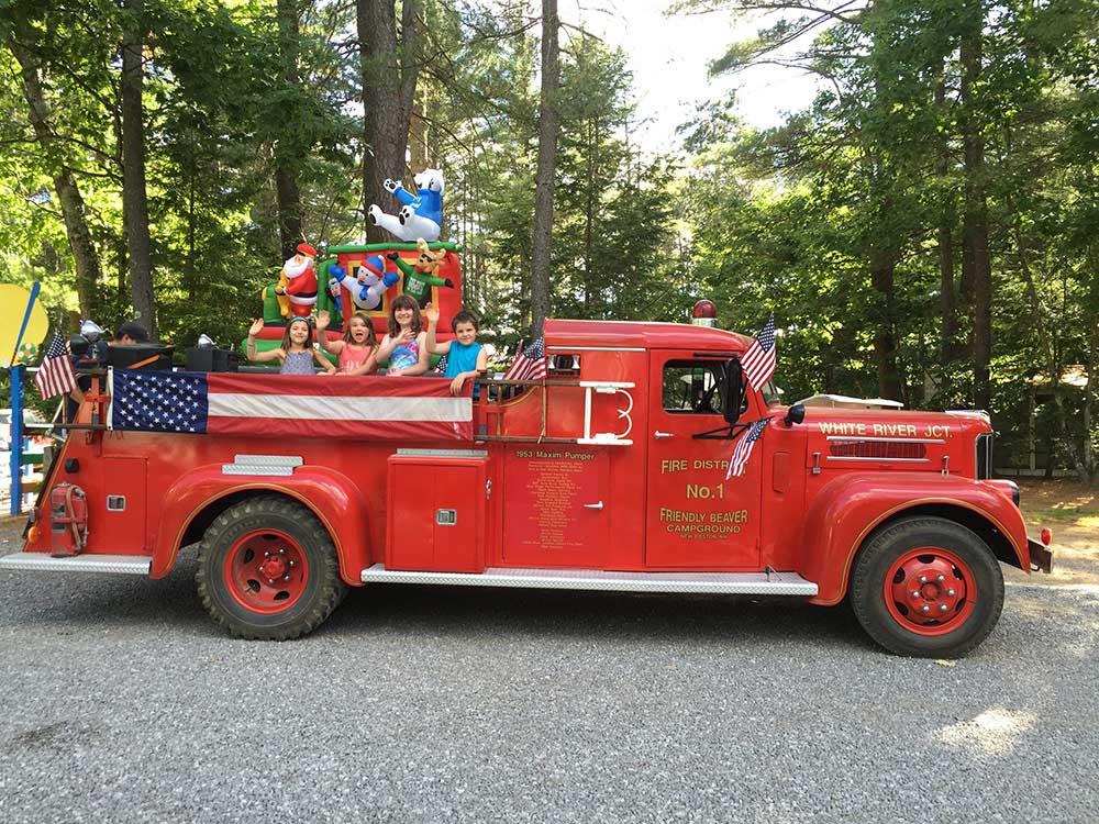 A vintage fire engine rolls through town.