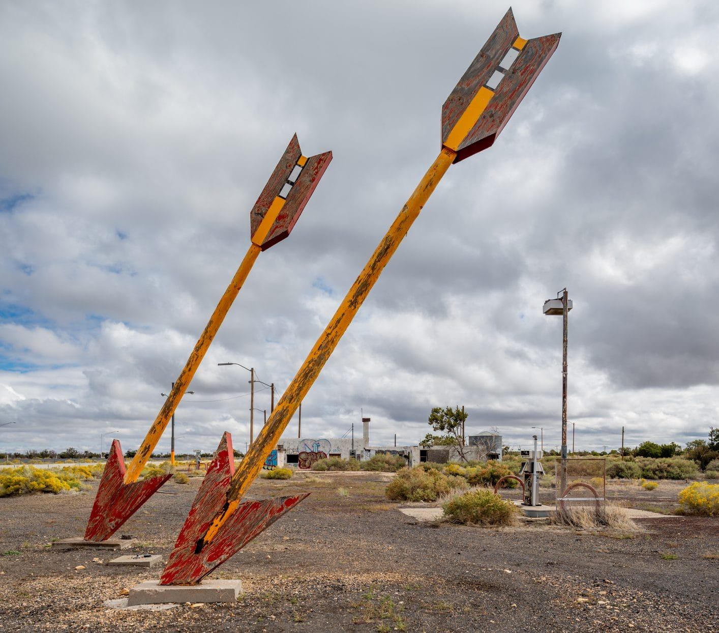 A pair of giant metal arrows in the ground.