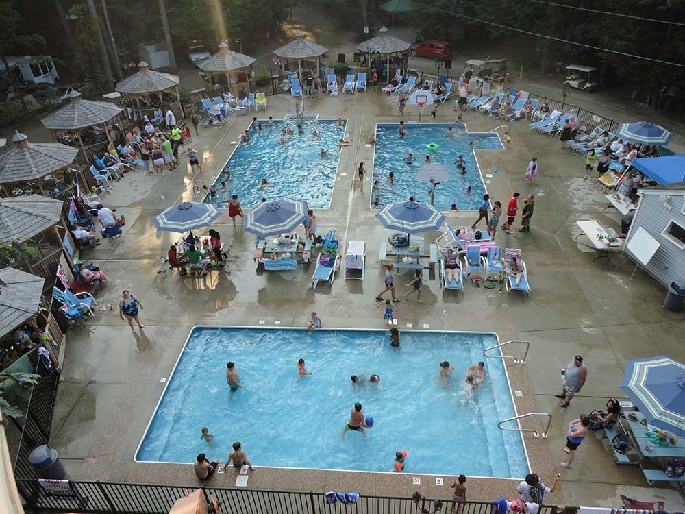 Aerial shot of three swimming pools