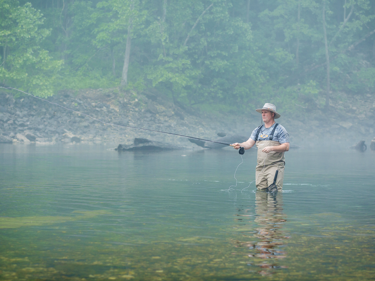 Man fly fishing in Eureka Springs