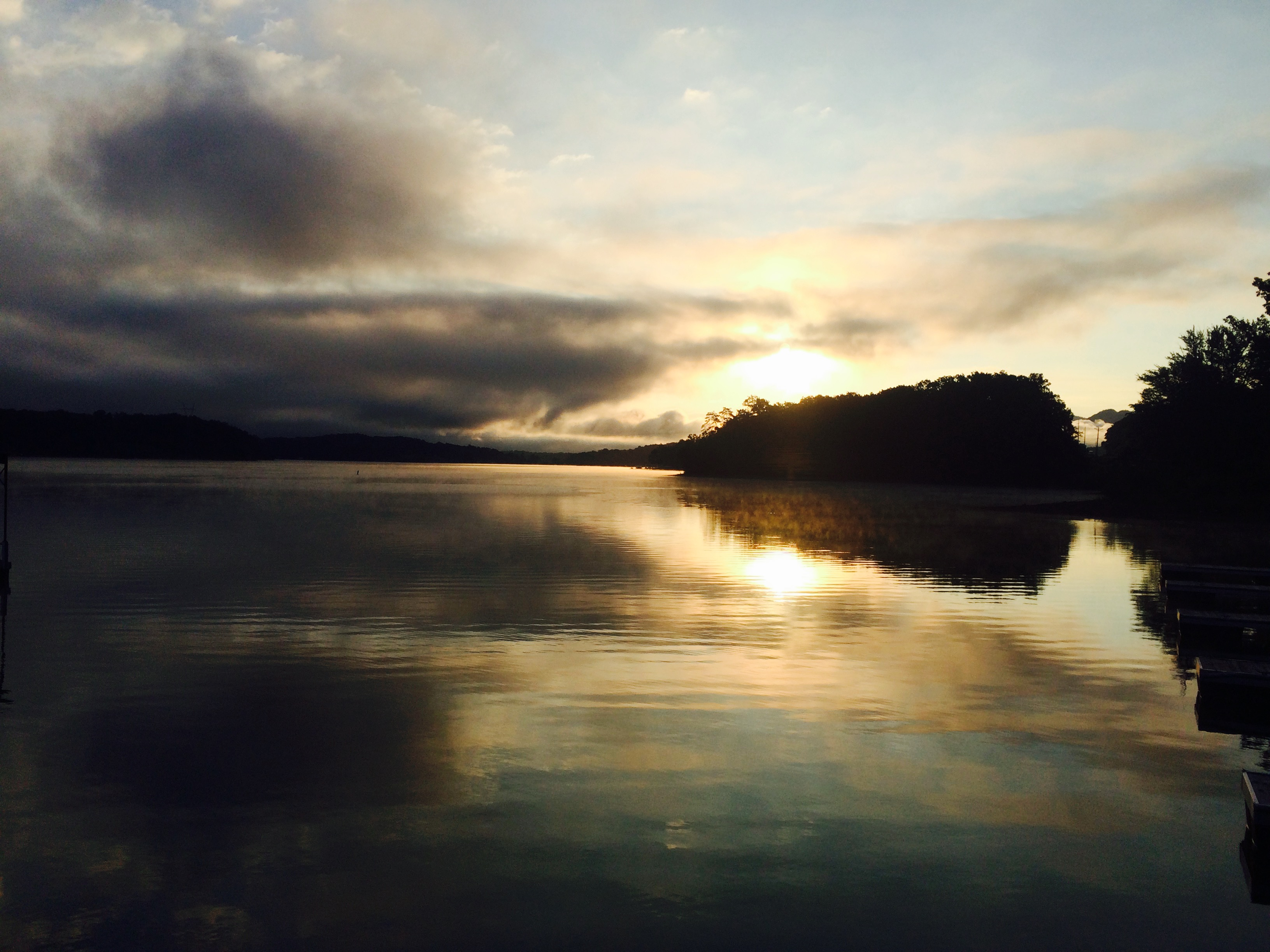 A sunset over a calm lake.