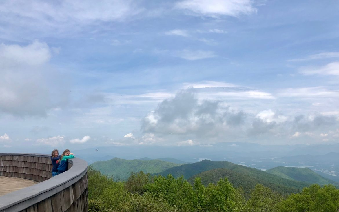 Two young girls standing at the summit on Brasstown Bald