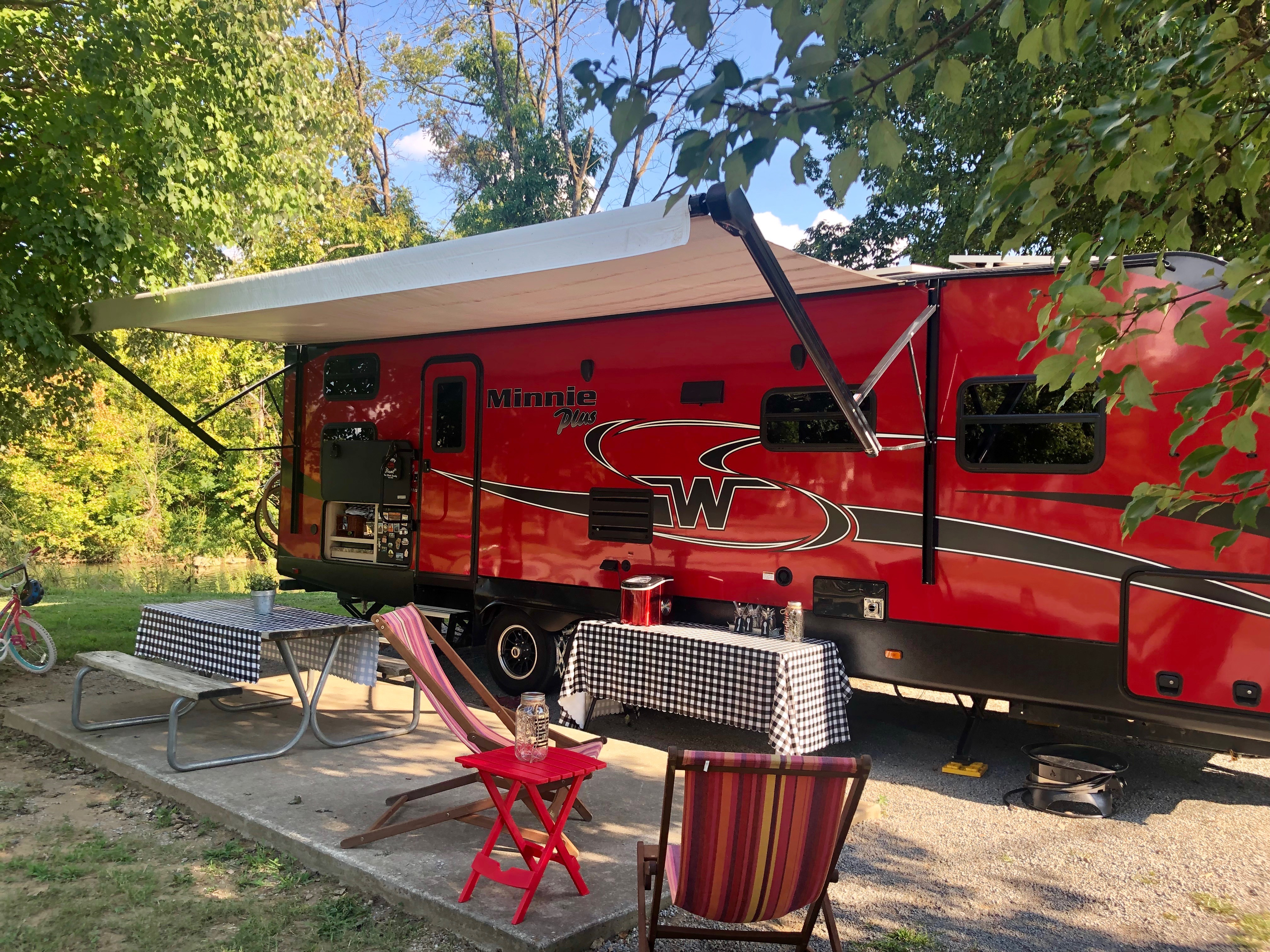 Red Winnebago RV camping in Pigeon Forge at River Plantation RV Resort