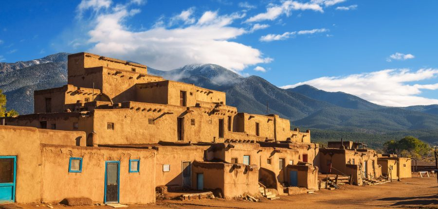 Ancient dwellings of Taos Pueblo in New Mexico on sunny day