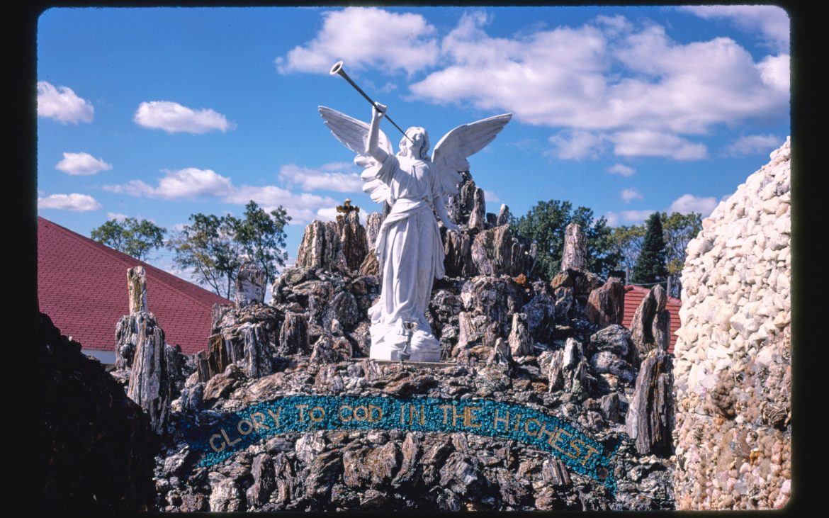 Angel with horn at Grotto of Redemption, West Bend, Iowa
