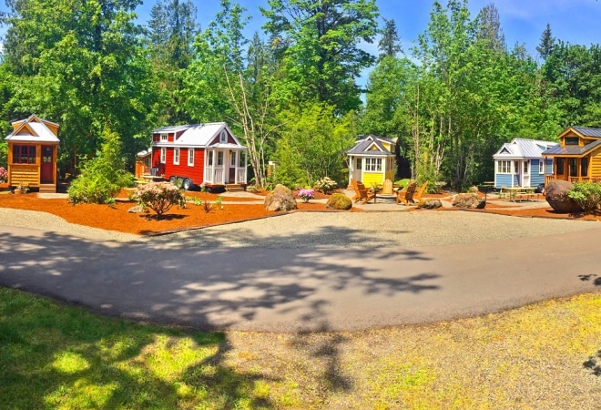 Colorful cabins arrayed around a clearing.
